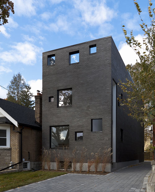 Charcoal House in Canada by Atelier rzlbd