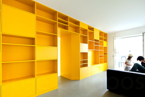 Portuguese Apartment with Yellow Storage Wall