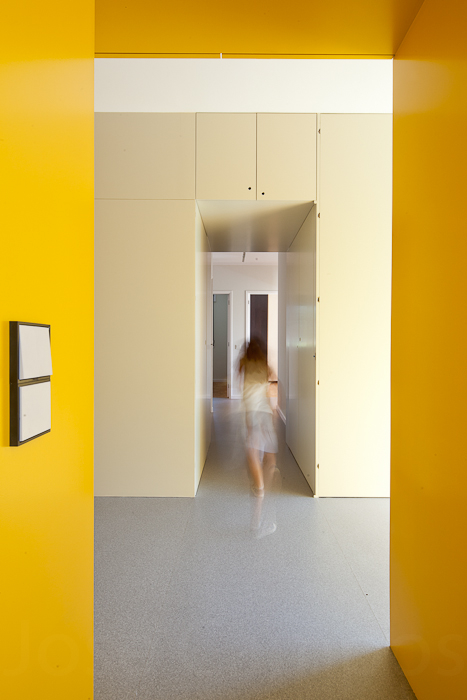 Portuguese Apartment with Yellow Storage Wall in main interior design  Category