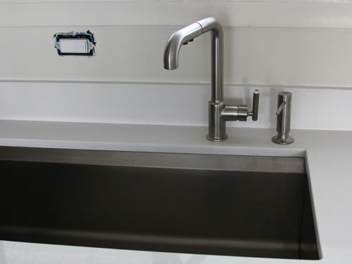 Water Pools In Stainless Kitchen Sink