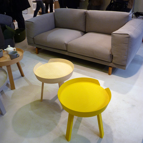 Muuto yellow table and grey sofa at Maison et Objet