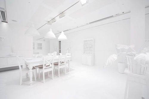 She built a large white room like environment  complete with furniture   plants  lighting  and artwork that set the stage for what was to come. The Obliteration Room by Yayoi Kusama   Design Milk