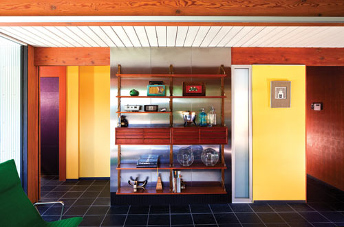 The Stainless Steel Wall Clad With Inexpensive IKEA Panels Continues Metal Theme Of Addition And Kitchen Behind Midcentury Unit Is A
