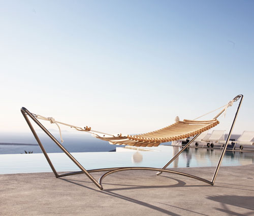 made of plywood beams that prevent your back from slouching the hammock has an adjustable footrest and armrests that open when you want them     la seora hammock   design milk  rh   design milk