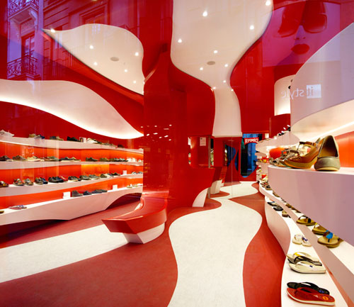 Curvy Red and White Camper Shoe Store Renovation by A-cero