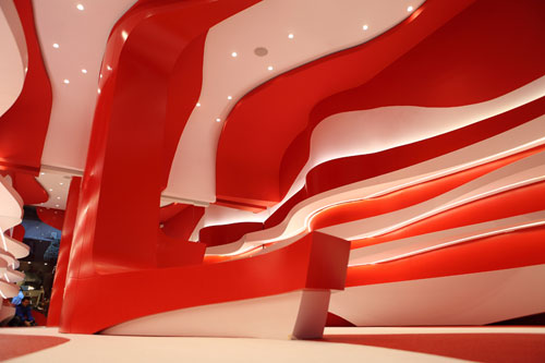 Curvy Red and White Camper Shoe Store Renovation by A cero in main interior design architecture  Category