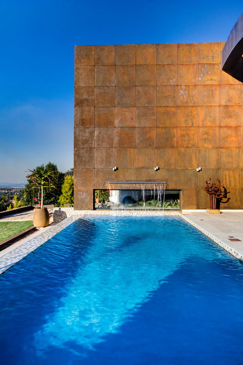 Sculptural Steel Walls and Infinity Pool: House The by Nico van der Meulen Architects in main architecture  Category
