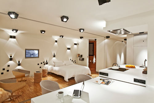 unique artistic lighting concept in a barcelona apartment by