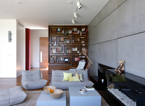 I love how the gray Ligne Roset Togo sofa matches walls  House with Pre Cast Concrete Panels by Auerbach Halevy Architects