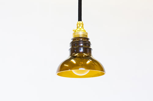 Reusing glass bottles to make lamps utrem lux by degross for Glass bottles with lights in them