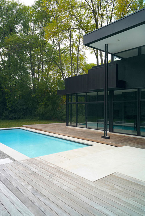 Modern Black and White Family Home in Canada by Guido Costantino in main architecture  Category