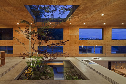 Partially Underground Nest House by UID Architects