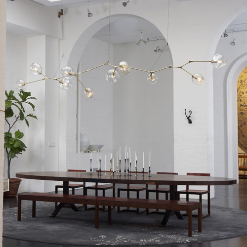 Amazing A custom globe Bursting Branch chandelier installed