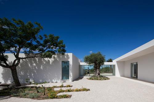 Irregular Geometry and Glass Hallways: House by Vitor Vilhena Architects