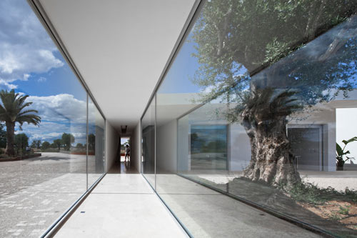 Irregular Geometry and Glass Hallways: House by Vitor Vilhena Architects in main architecture  Category