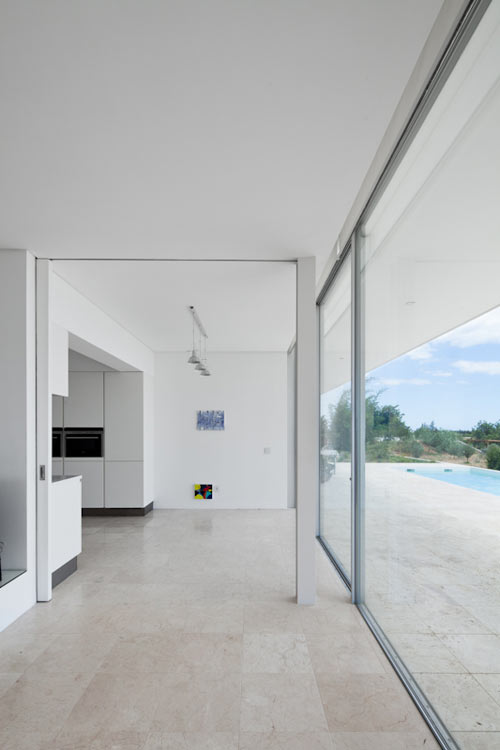 Irregular Geometry and Glass Hallways: House by Vitor Vilhena Architects in architecture  Category