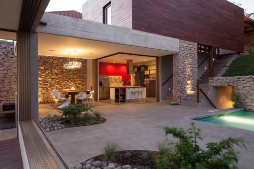 Rustic Meets Modern: Casa Jardin by Cinco Patas al Gato in main architecture  Category