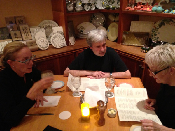 dailies-acme-17-seated-at-dinner-table