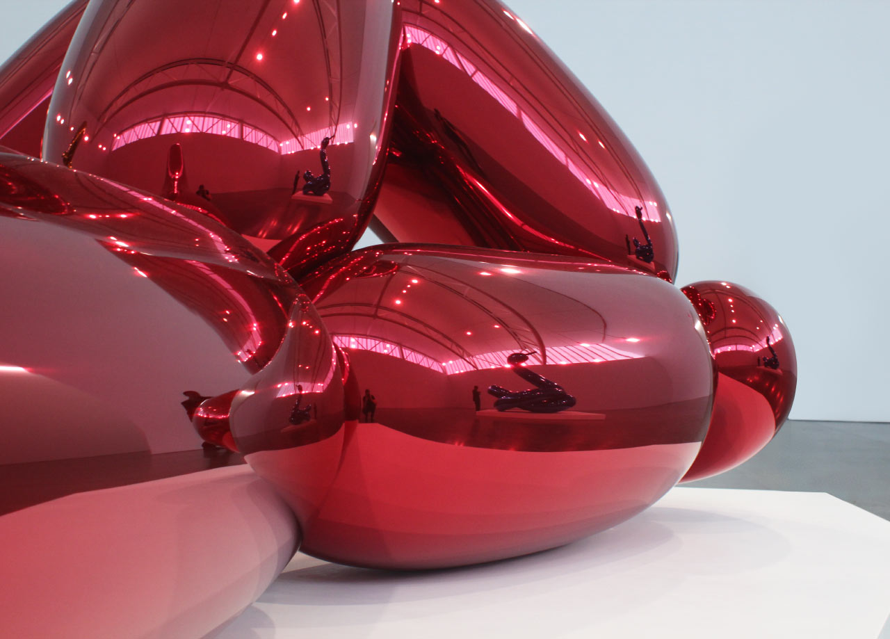 "JEFF KOONS ""Balloon Monkey (Red)"" (detail) 2006-2013. High chromium stainless steel with transparent color coating. © Jeff Koons. Courtesy Gagosian Gallery."