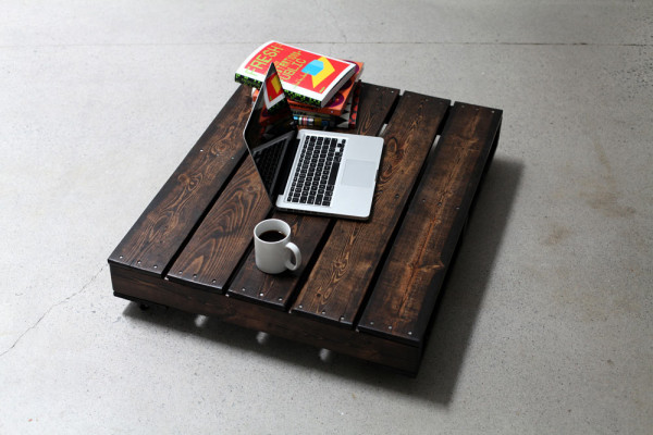 Table on castors, handcrafted from reclaimed wood by an employee