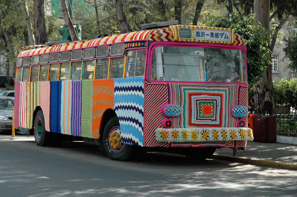 Yarn Bombed Bus by Magda Sayeg