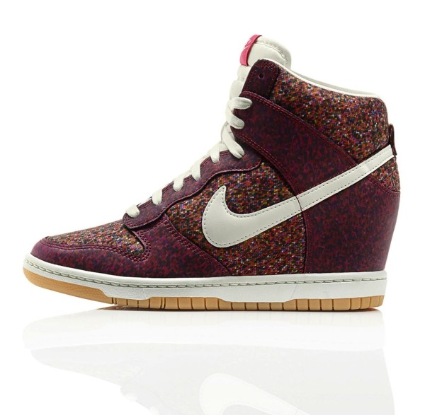 The Nike Dunk Sky Hi shoe features the distinctive print and a concealed wedge for extra height and style.