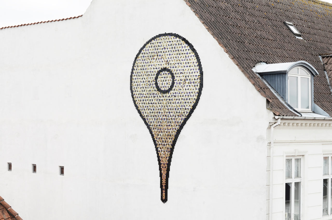 Giant Map Pin Installation Made of Metallic Discs