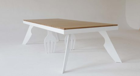 A Table Held Up By Giant Forks and Knives by Tcherassi Vilató