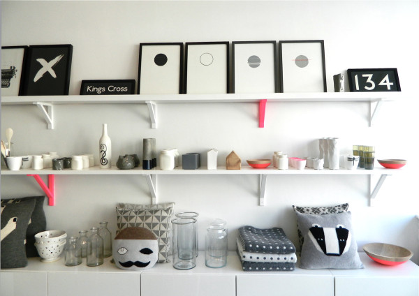 The four circle prints on the top shelf are by Hannah Jordan.