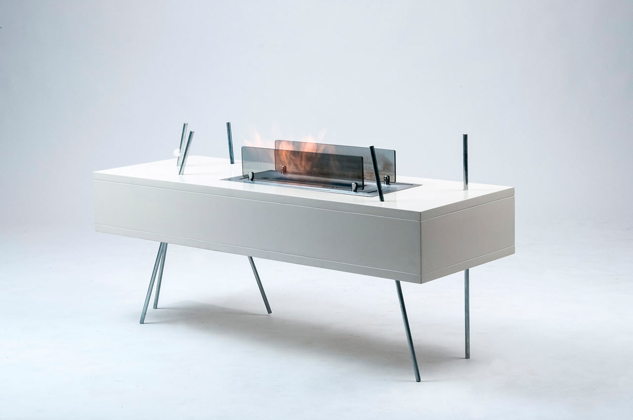 modern freestanding fireplace and coffee table in one design milk