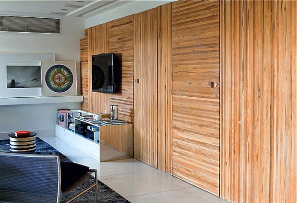 wood wall paneling and book shelves for contemporary living room design