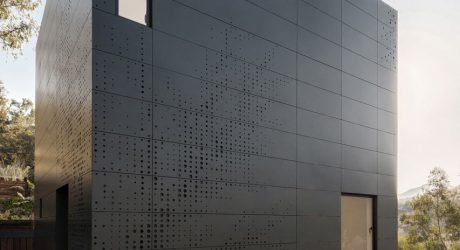 A Stacked Module House with a Perforated Facade