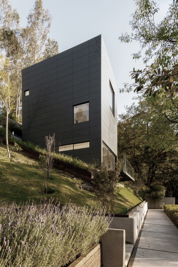 A Stacked Module House with a Perforated Facade in main architecture  Category