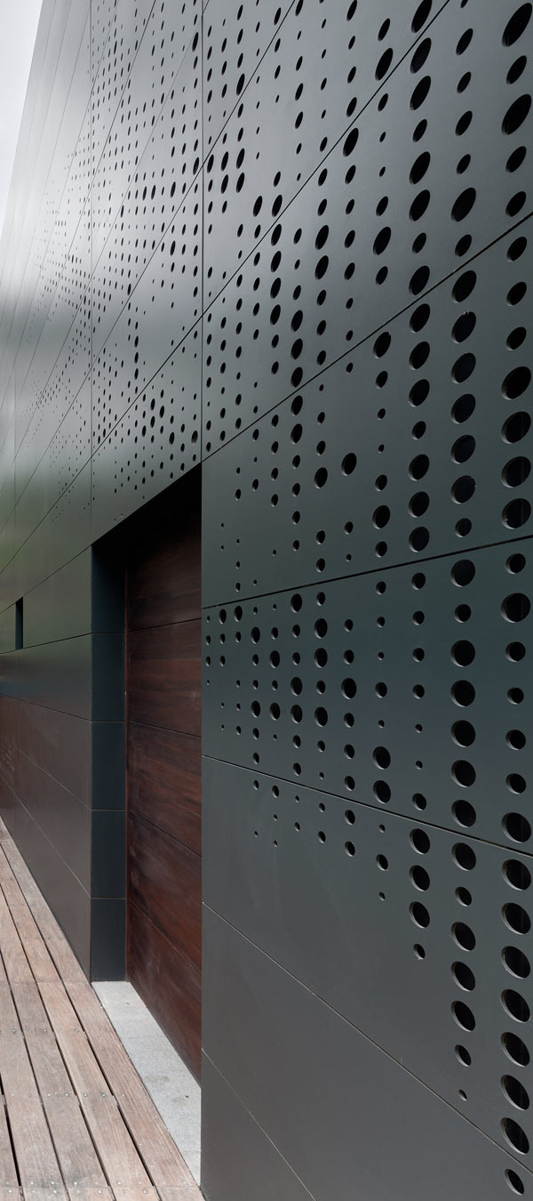 A Stacked Module House with a Perforated Facade in architecture Category