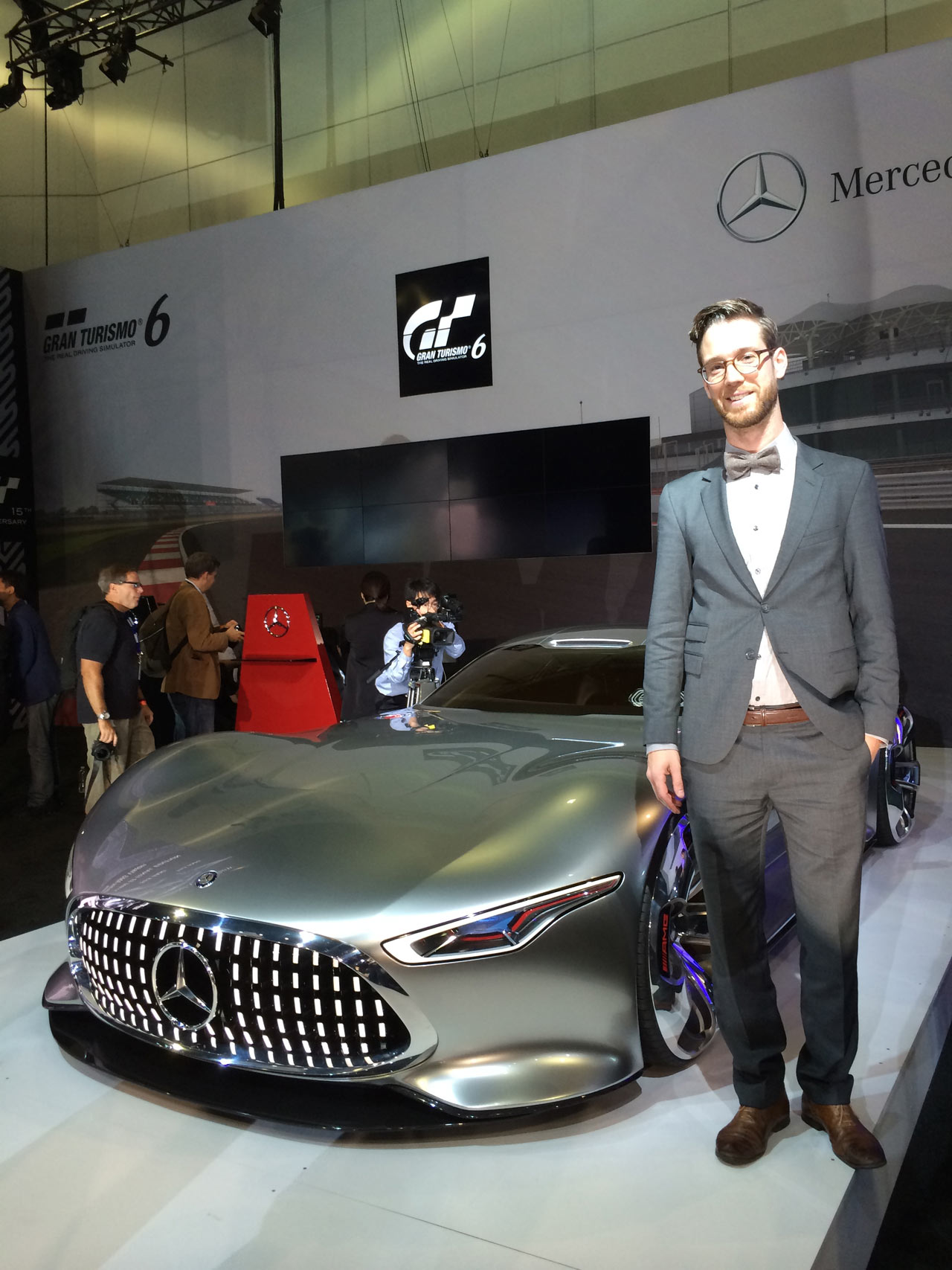 Bastian Baudy stands with his Mercedes concept design at the LA Auto Show