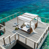 Dusit-Thani-Maldives-Hotel-Resort-12-private-dining-deck