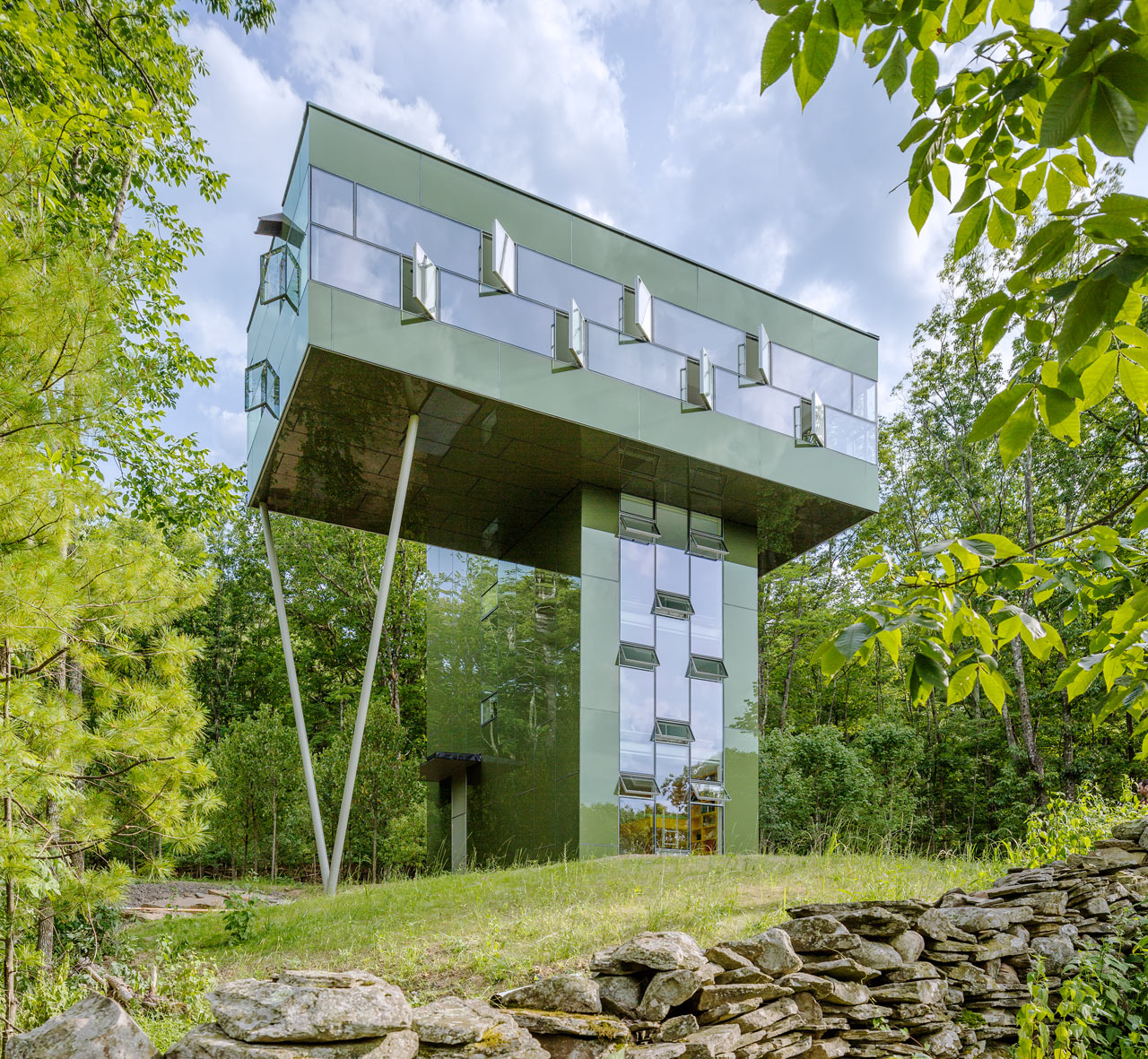 A Tower House That Leads to the Treetops