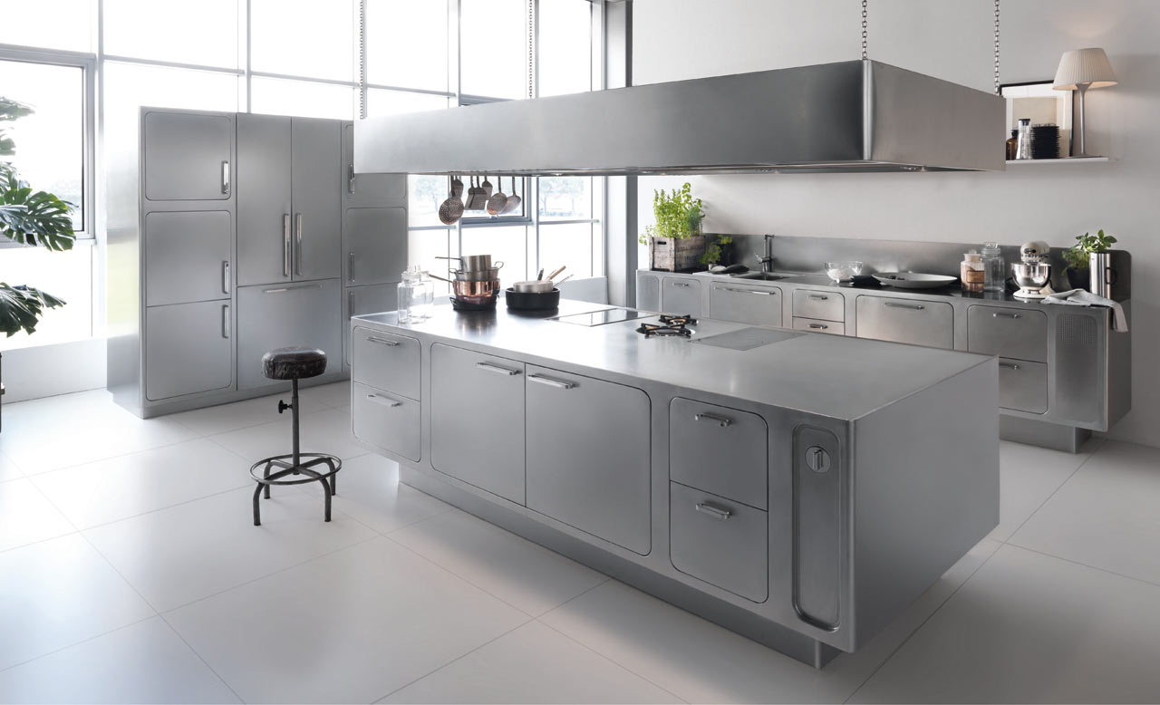 A stainless steel kitchen designed for at home chefs for Kitchen cabinets stainless steel