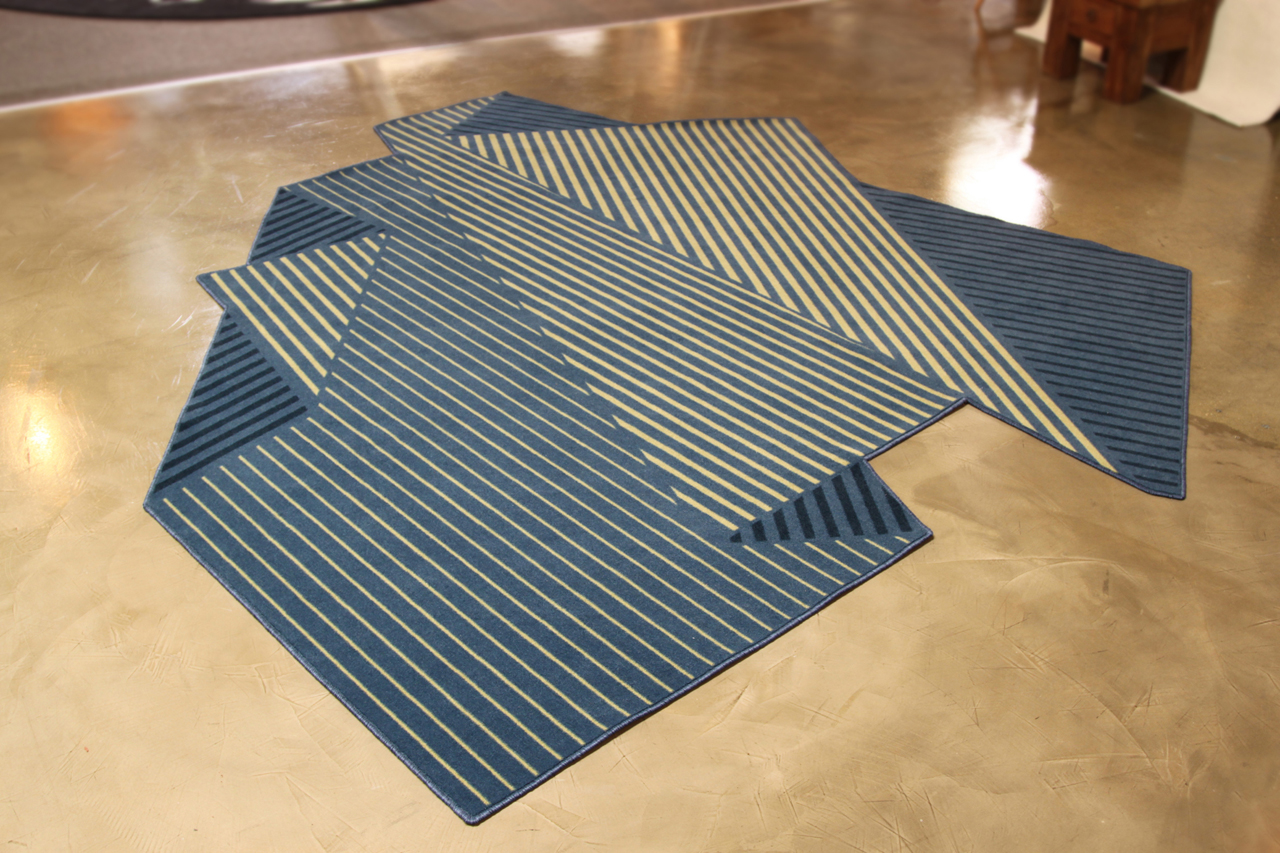 a rug that resembles a folded sheet of paper . a rug that resembles a folded sheet of paper  design milk