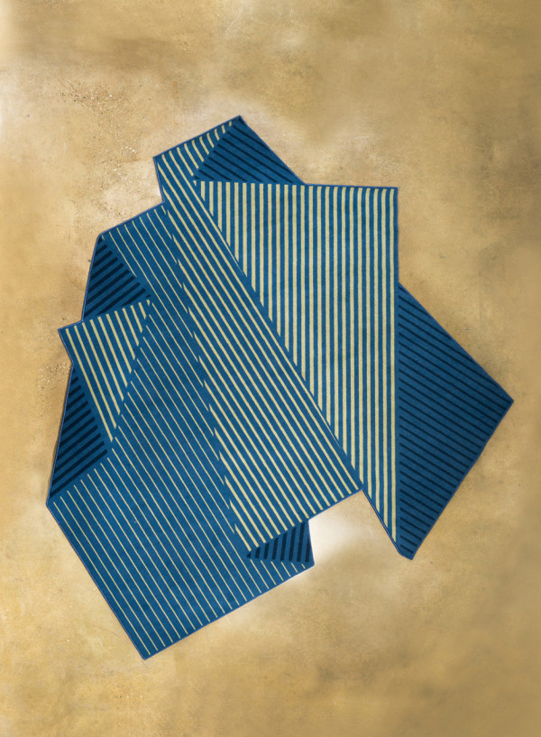 A Rug That Resembles a Folded Sheet of Paper in main home furnishings  Category