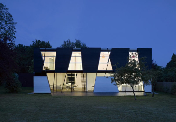 A Black & White House with Geometric Details in architecture Category