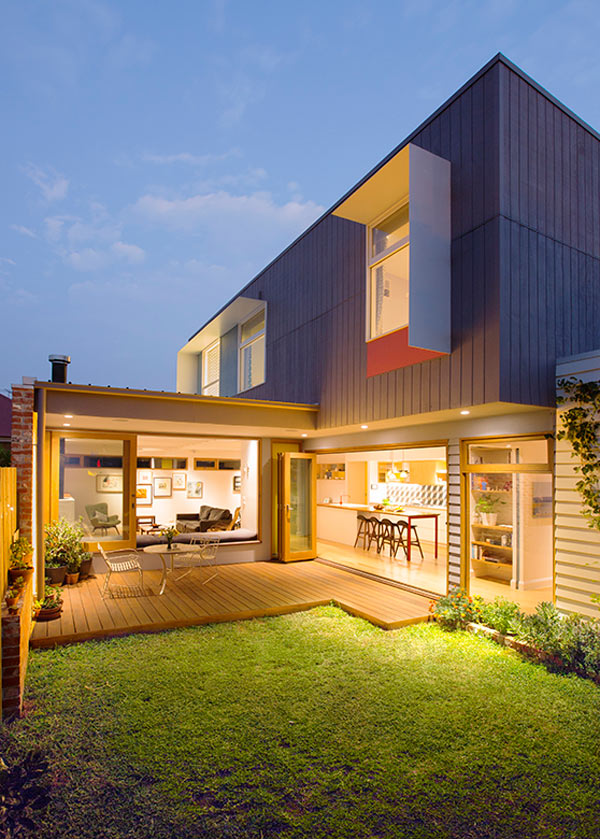A Colorful House That's Built in a Backyard