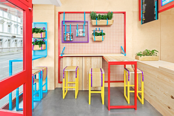 A Bright & Colorful Restaurant with Branding to Match in main interior design art  Category