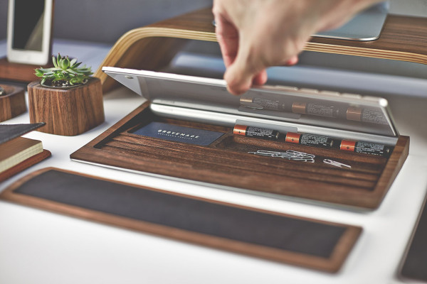 Available in both black walnut and maple, the Grovemade Keyboard Tray is designed for use with the Apple wireless keyboard. A cork padded aluminum base and cork padding offers storage for small stationery items, including three AA batteries.