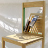 lXl Narcissus chair with newspaper and books