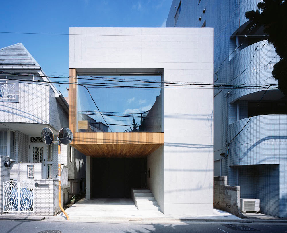 FRAME: A House Built with Exposed Concrete to Reduce Costs