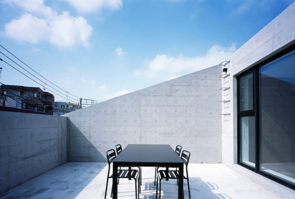 FRAME: A House Built with Exposed Concrete to Reduce Costs in main architecture  Category
