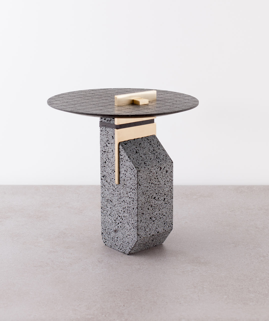 Name of work : Small Pillar Materials: Basalt, Occhio di pernice basalt, brass, textile Dimensions: 35X35Xh50 cm