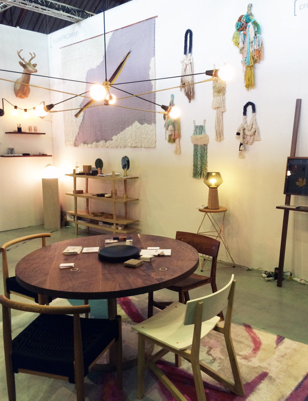 Foreground: work by Jeff Martin Joinery, 100xbtr, Brendan Ravenhill, Phloem Studio. Rug by Zoe Pawlak. Background: wall hangings on right by Tanya Aguiniga and on left by Mimi Jung with lighting by 100xbtr and leaning curio piece by PECA. Gold cable knit deer Trophy by Rachel Denny