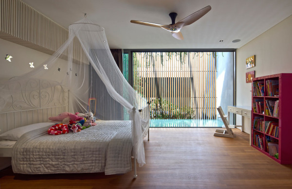 A 100 year old shophouse gets an extensive renovation for 15 year old bedroom